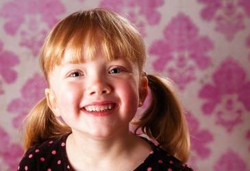 Girl on Pink Wallpaper Backdrop