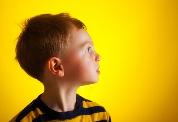 Child on Yellow Backdrop