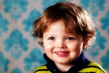 Boy on Blue Wallpaper Backdrop