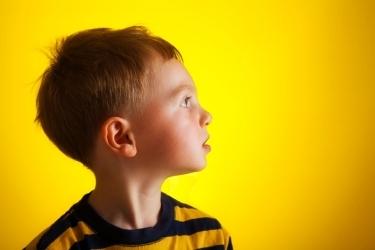 Child on Yellow Backdrop